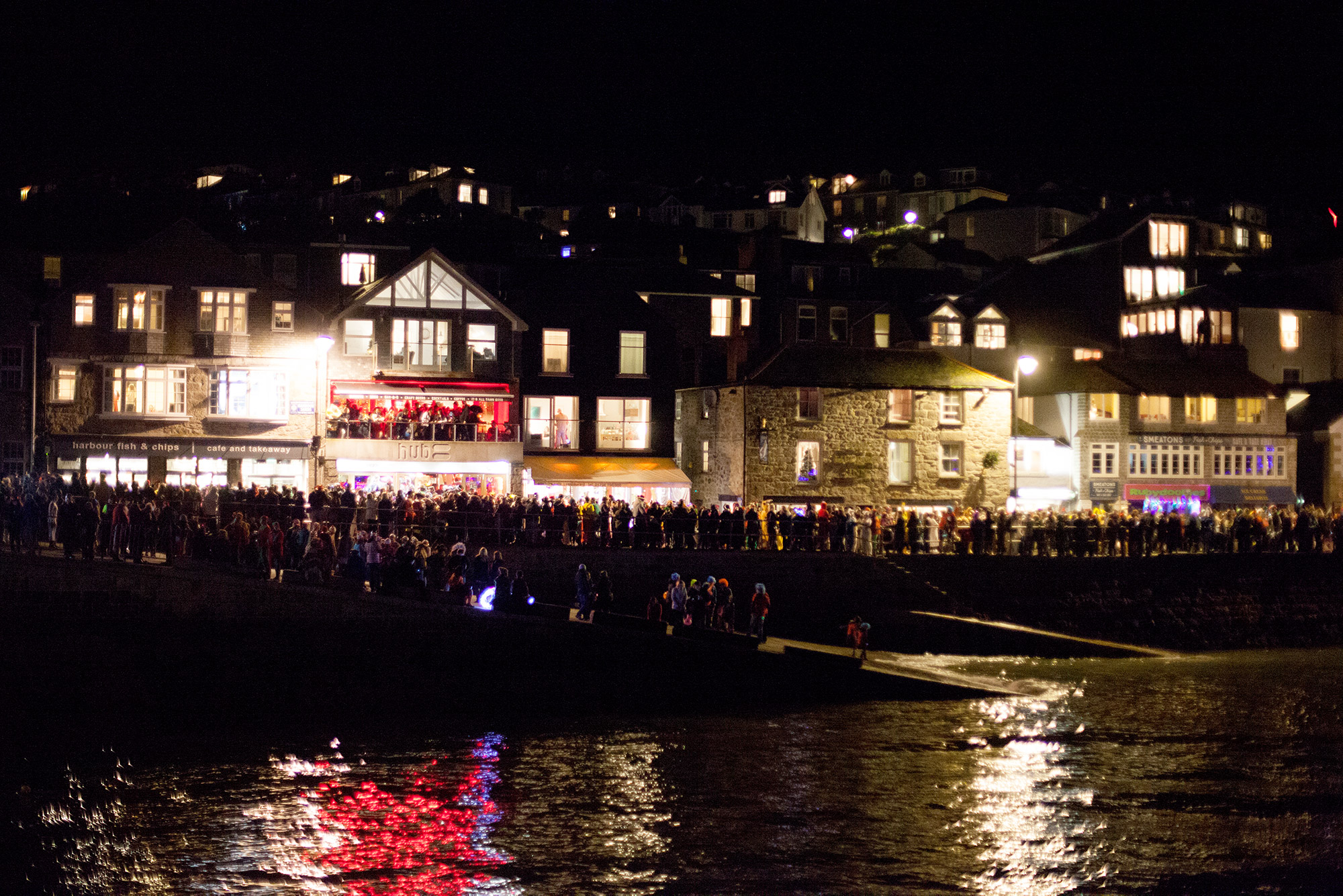 New Years eve revelers watch Firework display over St Ives Harbour